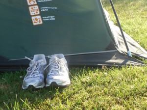 Trainers outside tent