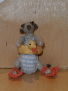 No one wants to see a picture of me in a swimming costume, please accept a knitting flipper-wearing meerkat as an alternative.